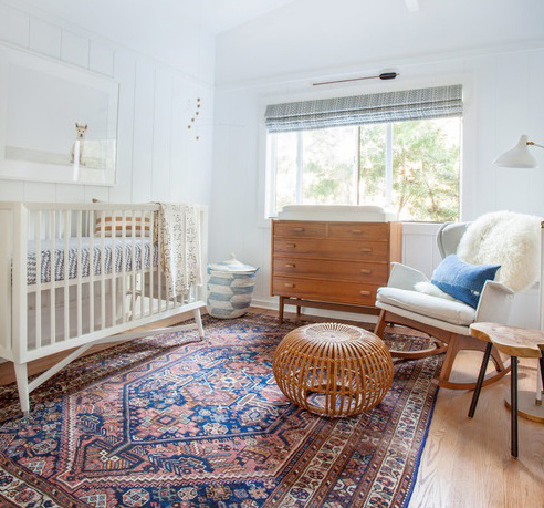 Choosing a rug: tribal area rug adding a warm touch to a child's nursery