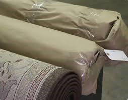 Golden rules of rug care: rolled up oriental rugs wrapped in plastic