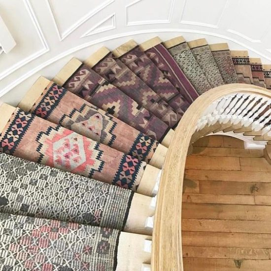 Area Rugs: This staircase features flat-woven rugs otherwise known as kilims. Their earth tone color palette adds warmth, comfort and culture to the staircase.