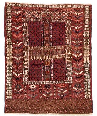 A Tekke rug where we can observe the mihrab at the top of it's cross design.