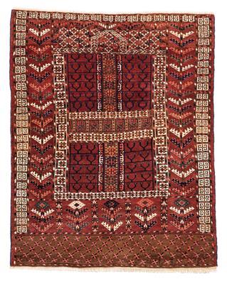 Un tapis Tekke sur lequel on peut voir le mihrab.
